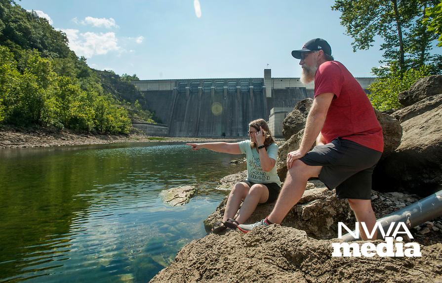 NWA Democrat-Gazette/BEN GOFF @NWABENGOFF<br /> Jennifer Wingo and husband Travis Wingo of Ramona, Okla. look at the water Friday, Aug. 3, 2018, in the White River below Beaver Dam.
