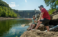 NWA Democrat-Gazette/BEN GOFF @NWABENGOFF<br /> Jennifer Wingo and husband Travis Wingo of Ramona, Okla. look at the water Friday, Aug. 3, 2018, in the White River below Beaver Dam.