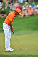 Bethesda, MD - July 2, 2017: Rickie Fowler sinks a putt for parr on the seventeenth hole during final round of professional play at the Quicken Loans National Tournament at TPC Potomac at Avenel Farm in Bethesda, MD.  (Photo by Phillip Peters/Media Images International)