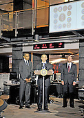 McLean, VA - October 6, 2009 -- Michael Leiter, Director, National Counterterrorism Center, center, introduces United States President Barack Obama, left, as the President prepares to make remarks during a visit to the National Counterterrorism Center (NCTC) in McLean, VA on Tuesday, October 6, 2009.  At right is Dennis Blair, Director of National Intelligence..Credit: Ron Sachs / Pool via CNP