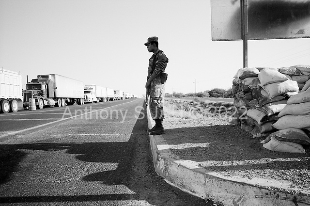 El Desenga&ntilde;o, Sinaloa.Mexico<br /> June 13, 2007<br /> <br /> Over 140 Mexican military personal operate one of the largest anti-drug check-points in Mexico on the northern Sinaloa border, near Sonora. All vehicles, cars, buses, trucks and passengers are thoroughly inspected for illegal drugs as they head north.