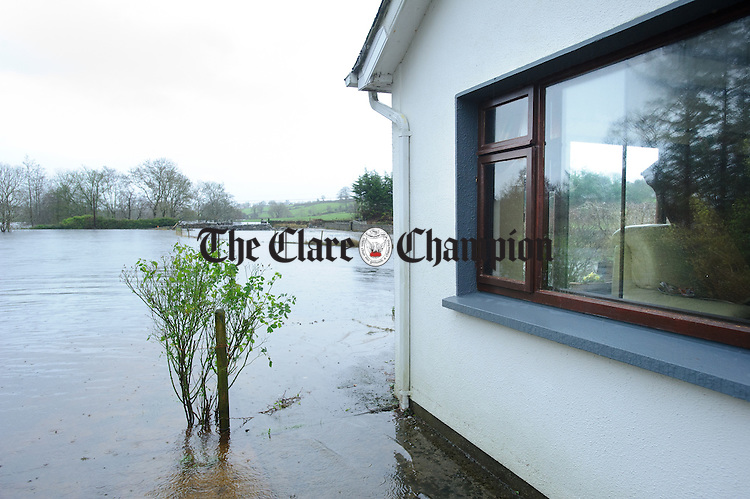 Furniture can be seen stacked up from the floor in the window of a home on the road from Castledaly to Bullaunagh as the flood waters rise in the Peterswell area of South Galway. Photograph by John Kelly.