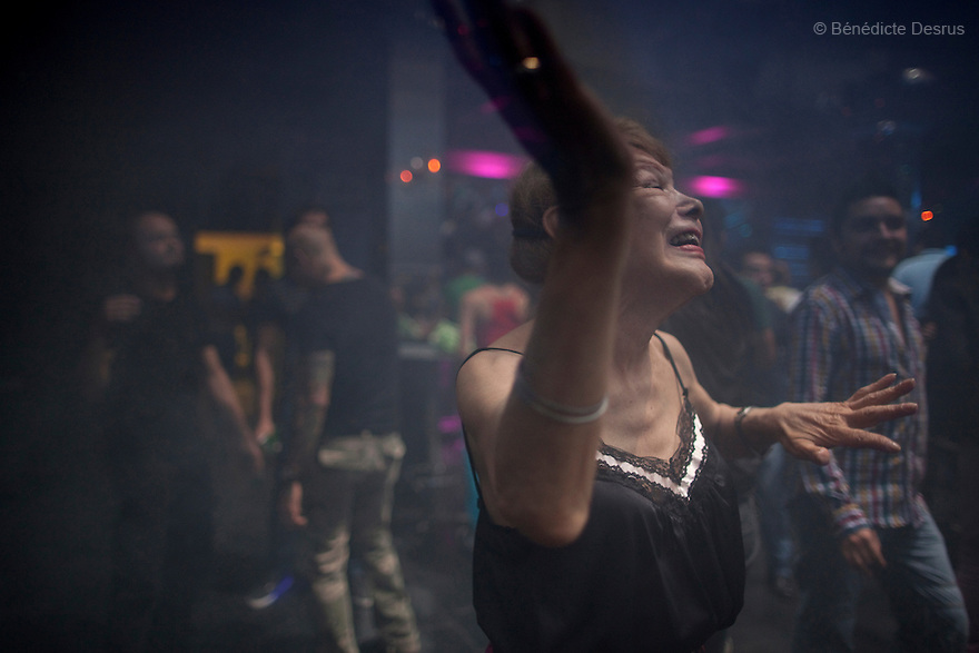 "September 8, 2012 - Mexico City, Mexico - Samantha dances at a nightclub in Mexico City. Samantha Flores is an 80-year-old transgender woman from Veracruz, Mexico. She is a prominent social activist for LGBTQI rights and is the founder of the non-profit organization ""Laetus Vitae"", a day shelter for elderly gay people in Mexico City. Senior citizens in general are many times prone to neglect and abandonment by their families, leaving them all but invisible. Their plight can be even worse if they are homosexual. Photo credit: Bénédicte Desrus"