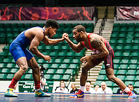 Jordan Burroughs of the United States (cq), wrestles Pedro Orlando Martinez Chen of Guatemala in the qualifying round of the Pan American Championships at Dr. Pepper Arena in Frisco, Texas, Friday, Saturday 27, 2015. Burroughs went on to win the match 10-0 and eventually win gold at the event.<br /> <br /> Photo by Matt Nager