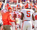 Clemson head coach Dabo Swinney talks to his team in the first half of an NCAA college football game against Florida State in Tallahassee, Fla., Saturday, Oct.27, 2018. (AP Photo/Mark Wallheiser)