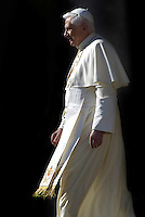 Pope Benedict XVI waves as he leads his weekly audience in Saint Peter's square at the Vatican 8-11-2006.. .