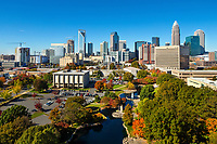 The Charlotte skyline with Marshall Park in the foreground. The park was originally constructed in 1973 as an Urban Renewal project. A 1.24 acre pond and fountain sit in the middle of the park. The park provides an open green space for citizens and lunch time patrons and is also capable of housing small to medium size events. The park is located at 800 East Third Street, the park covers 5.43 acres and is bordered by East Third Street, South McDowell Street.<br /> <br /> Charlotte Photographer - PatrickSchneiderPhoto.com