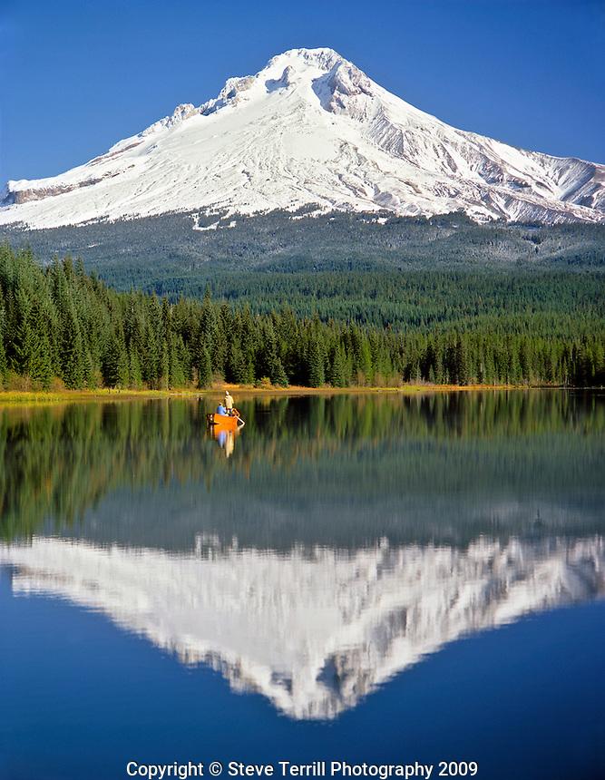 Fishing on Trillium Lake with Mt Hood looming on horizon in Clackamas County Oregon