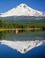 Fishing on Trillium Lake with Mt Hood looming on horizon in Clackamas County Oregon