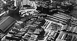 Pittsburgh PA:  Aerial view of Pittsburgh looking southwest at the Pennsylvania Railroad Station and lower strip district.  Image includes railroad yards, terminal, wholesale businesses, warehouses and manufacturing facilities - 1923