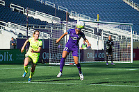 Orlando, Florida - Sunday, May 8, 2016: Orlando Pride defender Monica Hickman Alves (21) heads the ball to safety and away from Seattle Reign FC forward Beverly Yanez (17) during a National Women's Soccer League match between Orlando Pride and Seattle Reign FC at Camping World Stadium.