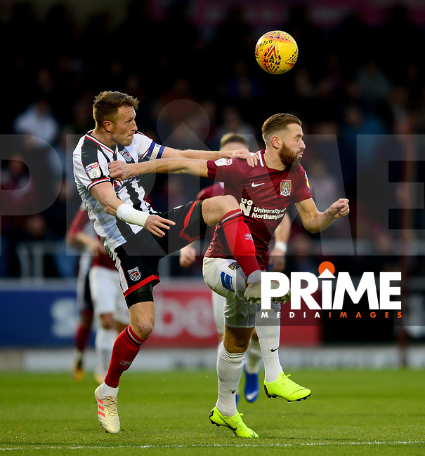 Kevin Van Veen of Northampton battles with Danny Collins  of Grimsby during the Sky Bet League 2 match between Northampton Town and Grimsby Town at Sixfields Stadium, Northampton, England on 24 November 2018. Photo by Bradley Collyer / PRiME Media Images.
