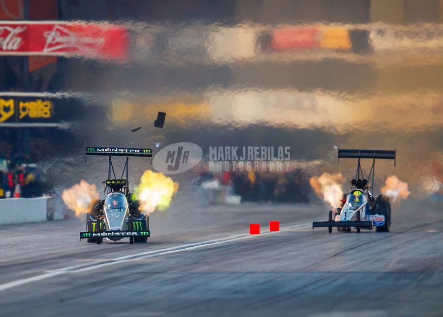 Nov 10, 2017; Pomona, CA, USA; NHRA top fuel driver Brittany Force (left) races alongside Blake Alexander during qualifying for the Auto Club Finals at Auto Club Raceway at Pomona. Mandatory Credit: Mark J. Rebilas-USA TODAY Sports