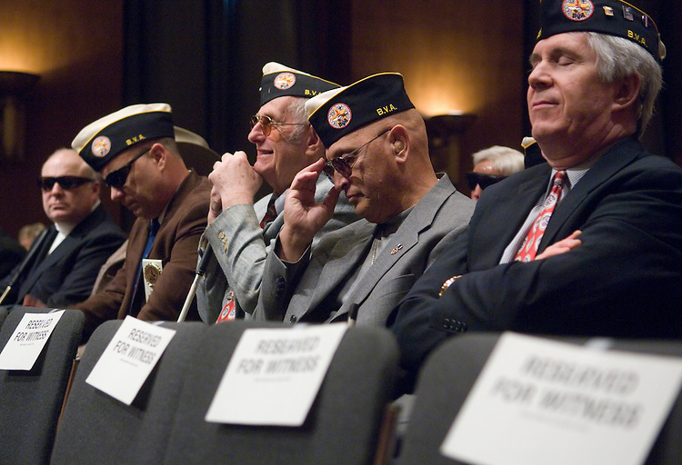 "Members of the Blind Veterans Association sit in the audience waiting for the start of the Senate Veterans' Affairs Committee and House Veterans' Affairs Committee joint hearing on ""Paralyzed American Veterans, Jewish War Veterans of the United States, and Blinded Veterans Assn. Legislative Presentation,"" on Thursday, March 8, 2007."