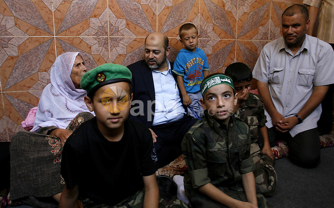 Senior Hamas official, Moussa Abu Marzouk speaks to mother of Raed Al-Attar during visit her in Rafah in southern Gaza strip on August 28, 2014. An open-ended ceasefire in the Gaza war held on Wednesday as Prime Minister Benjamin Netanyahu faced strong criticism in Israel over a costly conflict with Palestinian militants in which no clear victor has emerged. Israel launched an offensive on July 8, with the declared aim of ending rocket fire into its territory. Photo by Abed Rahim Khatib