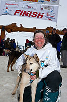Rookie Tamara Rose of Fairbanks poses with her lead dog Hailey after finishing the 2010 Iditarod in 43rd at the finish line in Nome, Alaska