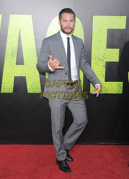 Taylor Kitsch.The World Premiere of 'Savages' held at The Grauman's Chinese Theatre in Hollywood, California, USA..June 25th, 2012.full length suit black white beard facial hair grey gray shirt hand fingers .CAP/RKE/DVS.©DVS/RockinExposures/Capital Pictures.