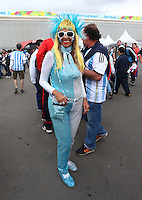 An Argentina supporter in glittery fancy dress outside the Arena Corinthians
