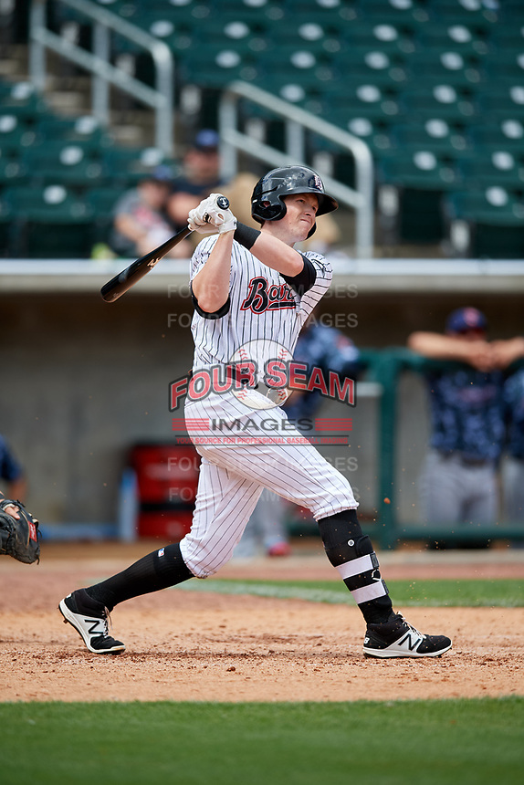 Birmingham Barons left fielder Cameron Seitzer (33) follows through on a swing during a game against the Jacksonville Jumbo Shrimp on April 24, 2017 at Regions Field in Birmingham, Alabama.  Jacksonville defeated Birmingham 4-1.  (Mike Janes/Four Seam Images)