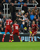 1st October 2017, St James Park, Newcastle upon Tyne, England; EPL Premier League football, Newcastle United versus Liverpool; Matt Ritchie of Newcastle United heads the ball back into the box with Philippe Coutinho Georginio Wijnaldum and Alberto Moreno of Liverpool unable to stop him