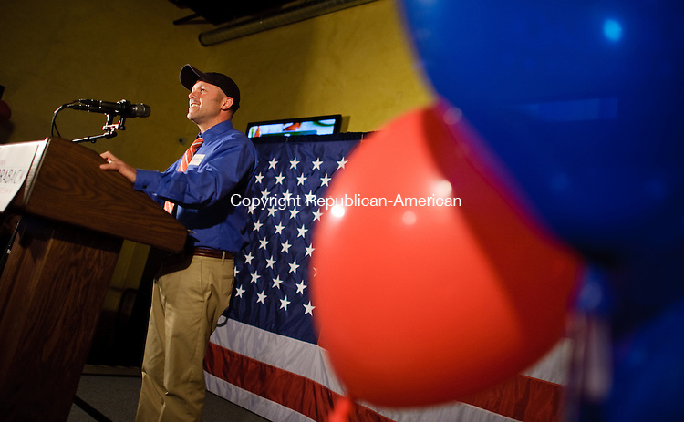 TORRINGTON, CT-6 November 2012-110612EC07-- Brian Mattiello, a close friend of Republican Andrew Roraback, calls out some early returns Tuesday night at Backstage in Torrington.   Early numbers were positive for the republican.  After Elizabeth Esty gained ground, Roraback made his concession speech shortly before midnight.  Erin Covey Republican-American