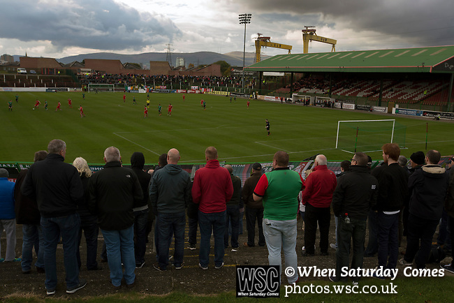 Glentoran 2 Cliftonville 1, 22/10/2016. The Oval, NIFL Premiership. Home supporters watching the first-half action at The Oval, Belfast as Glentoran hosted city-rivals Cliftonville in an NIFL Premiership match. Glentoran, formed in 1892, have been based at The Oval since their formation and are historically one of Northern Ireland's 'big two' football clubs. They had an unprecendentally bad start to the 2016-17 league campaign, but came from behind to win this fixture 2-1, watched by a crowd of 1872. Photo by Colin McPherson.