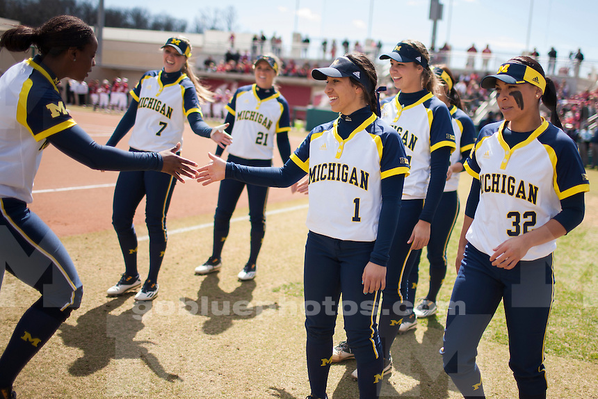 Michigan's Sierra Lawrence, left, Abby Ramirez (1) and Sierra Romero (32) are seen before an NCAA college softball game on Saturday, April 2, 2016, in Bloomington, Indiana. (Photo by James Brosher)