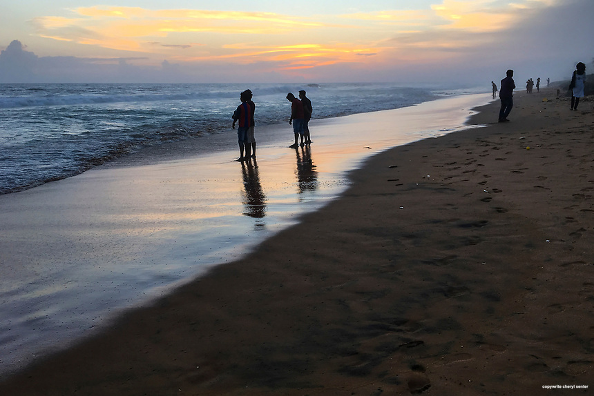 Locals come to cool off and watch the sunset on the shore of the Indian Ocean at Sanghumugham Beach in Thiruvananthapuram, Kerala, India  June 17, 2017 (Cellphone Photo by Cheryl Senter)