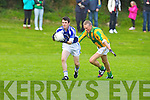 Templenoe's Denis O'Neill gets away from Lios Poil's John O Deargain in the novice championship semi-final at Firies on Sunday.