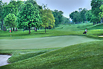 NCR country club, Dayton Ohio. Fairways and greens on golf course with golfer.