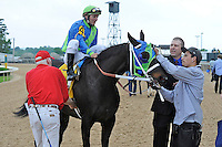 Outta Tune (no. 4), ridden by Terry Thompson and trained by Chris Richard, wins the 39th running of the grade 3 Count Fleet Handicap for three year olds and upward on April 14, 2012 at Oaklawn Park in Hot Springs, Arkansas.  (Bob Mayberger/Eclipse Sportswire)