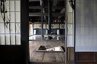 Japanese rice-paper Shoji screens partition the ktichen from the living area beyond