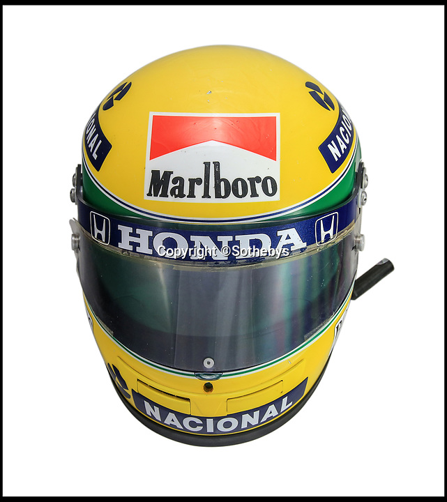 BNPS.co.uk (01202 558833)<br /> Pic:  Sothebys/BNPS<br /> <br /> A crash helmet that F1 legend Ayrton Senna wore on his way to his second World Championship has sold for £142,000. ($162,000)<br /> <br /> The Brazilian wore the green, yellow and blue head protection throughout the 1990 season when he was embroiled in a legendary battle with great rival Alain Prost.<br /> <br /> Senna, who was killed in a crash in 1994, wore the helmet in one of the most controversial moments in F1 history.<br /> <br /> Knowing that if Prost did not finish in the penultimate race of the season Senna would be world champion, he intentionally smashed into the Frenchman on the first corner.