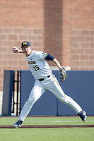 Michigan Wolverines third baseman Jimmy Kerr (15) makes a throw to first base against the Western Michigan Broncos on March 18, 2019 in the NCAA baseball game at Ray Fisher Stadium in Ann Arbor, Michigan. Michigan defeated Western Michigan 12-5. (Andrew Woolley/Four Seam Images)