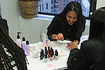 Guests receive manicures by OPI durig the L*Space Spring Summer 2016 collection preview on November 12, 2016.