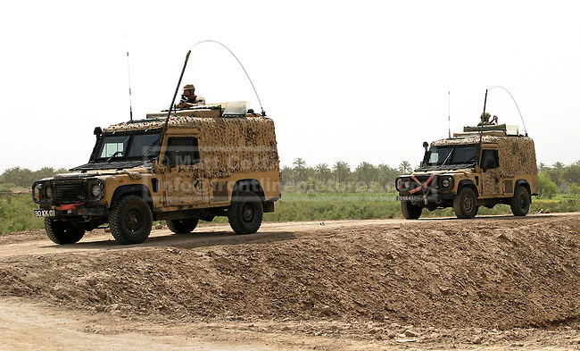 28/11/2012. FILE PICTURE 28/11/2012. British army 'Snatch' Land Rovers during a patrol outside of Basra City in Southern Iraq, in May 2005. Relatives of soldiers who were killed and injured using equipment, such as the Snatch Land Rover, have recently (19/10/12) received a judgment in the Court of Appeal stating that the Ministry of Defence - like any other employer - owed its soldiers a duty of care which extended to equipment on operations. Photo credit: Matt Cetti-Roberts