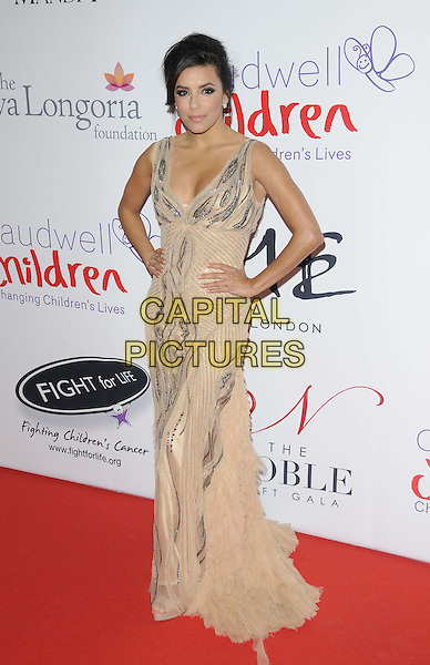 Eva Longoria.attended the Noble Gift Gala, ME London, The Strand, London, England, UK, 8th December 2012..full length beige nude dress silver long maxi sleeveless hands on hips low cut .CAP/CAN.©Can Nguyen/Capital Pictures.