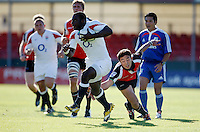 Photo: Richard Lane/Richard Lane Photography. .IRB Junior World Championship. England U20 v Canada U20. 10/06/2008. England's Miles Benjamin breaks past Canada's Nathan Hirayama.