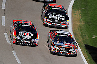 Nov. 7, 2009; Fort Worth, TX, USA; NASCAR Nationwide Series driver Kyle Busch (18) leads Kevin Harvick (33) and Kasey Kahne (10) during the O'Reilly Challenge at the Texas Motor Speedway. Mandatory Credit: Mark J. Rebilas-