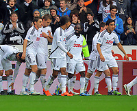 FAO SPORTS PICTURE DESK<br /> Pictured: Gylfi Sigurdsson of Swansea (2nd L) celebrating his goal. Saturday, 14 April 2012<br /> Re: Premier League football, Swansea City FC v Blackburn Rovers at the Liberty Stadium, south Wales.