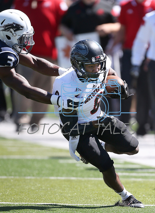 Southern Utah's Chris Robinson (6) runs against Nevada defender Kaodi Dike (3) during the second half of an NCAA college football game on Saturday, Aug. 30, 2014, in Reno, Nev. (AP Photo/Cathleen Allison)