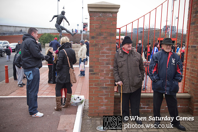 Middlesbrough 1 Preston North End 1, 22/01/2011. Riverside Stadium, Championship. Supporters gather near a statue of former player Wilf Mannion outside Middlesbrough FC's Riverside Stadium on the day the club played host to Preston North End in an Npower Championship fixture. The match ended in a one-all draw watched by a crowd of 16,157. Middlesbrough relocated from their former home at Ayresome Park in 1995. Photo by Colin McPherson.