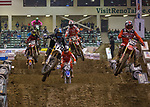 Riders compete in the 250 AX class of the Arena Cross motorcycle event held in the Reno Livestock Events Center on Saturday April 28, 2018.