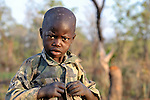 A boy gets dressed early in the morning in the Southern Sudan village of Kupera. NOTE: In July 2011, Southern Sudan became the independent country of South Sudan