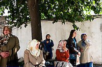 ISTANBUL - MAY 25, 2007:   A group of women wait on the side of the street in Istanbul, Turkey. Photo by Landon Nordeman.
