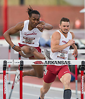 NWA Democrat-Gazette/BEN GOFF @NWABENGOFF<br /> Tre'Bien Gilbert (left) and Gabe Moore of Arkansas run in the final heat of the men's 110 meter hurdles Friday, April 12, 2019, at the John McDonnell Invitational at John McDonnell field in Fayetteville. Gilbert placed third and Moore was fifth.