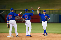AZL Cubs Cam Balego (82), Delvin Zinn (21), and Tolly Filotei (24) congratulate one another after a victory against the AZL Padres 2 on August 28, 2017 at Sloan Park in Mesa, Arizona. AZL Cubs defeated the AZL Padres 2 9-4. (Zachary Lucy/Four Seam Images)