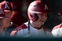 Arkansas right fielder Heston Kjerstad smiles Friday, Feb. 14, 2020, as he celebrates with teammates in the dugout after hitting a home run during the fifth inning against Eastern Illinois at Baum-Walker Stadium in Fayetteville. Visit nwaonline.com/200214Daily/ for today's photo gallery.<br /> (NWA Democrat-Gazette/Andy Shupe)