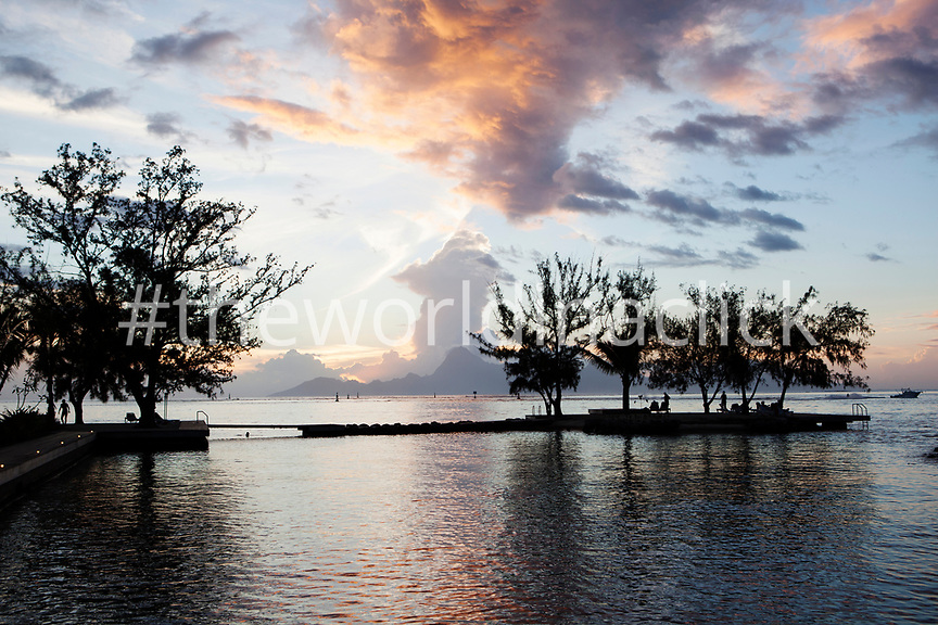 FRENCH POLYNESIA, Tahiti. View of Moorea Island in the distance at sunset as seen from the Manava Suite Resort Tahiti.