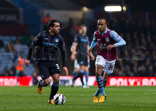 04.03.2013 Birmingham, England.  Manchester City's Carlos Tévez and Aston Villa's Fabian Delph in action during the Premier League game between Aston Villa and Manchester City from Villa Park.